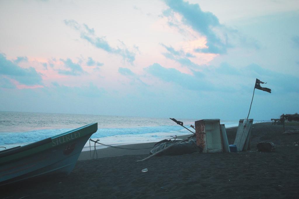 a beach an ocean and a tattered flag